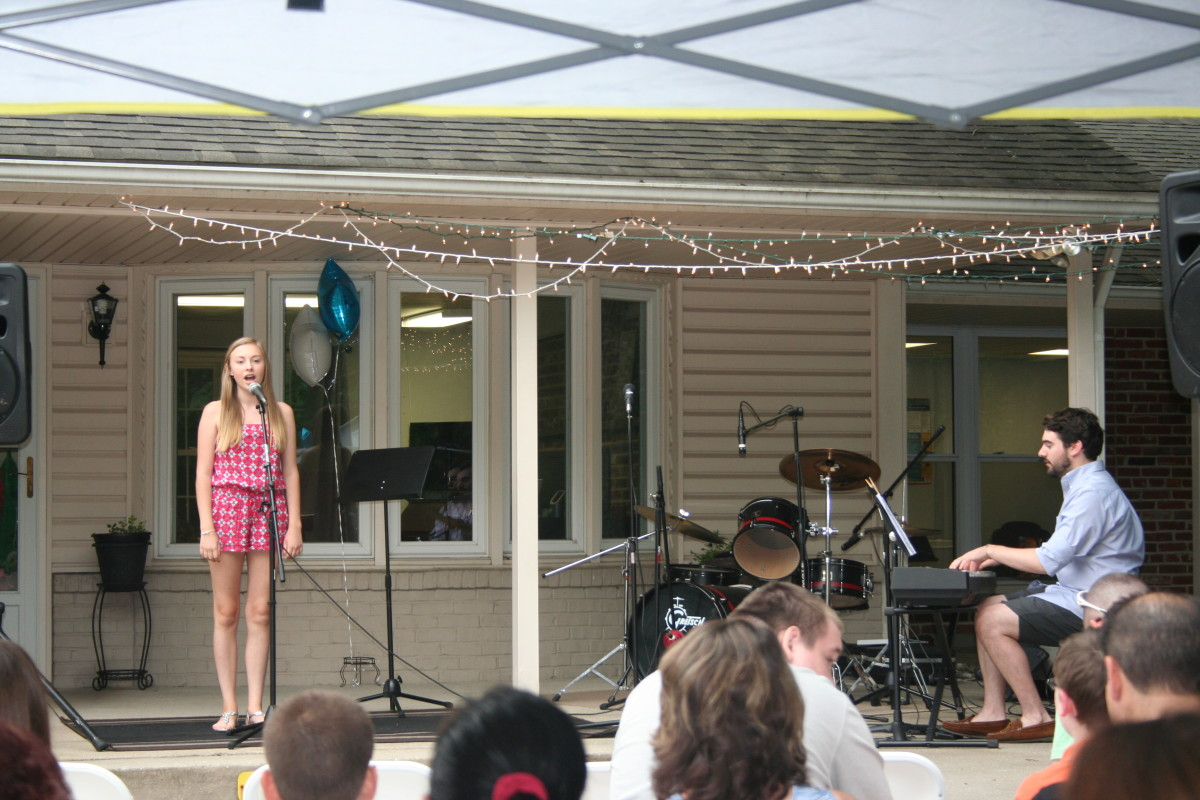 Resonance Student Ashleigh N. and Vocal Teacher Christopher Flaherty performing at the BBQ