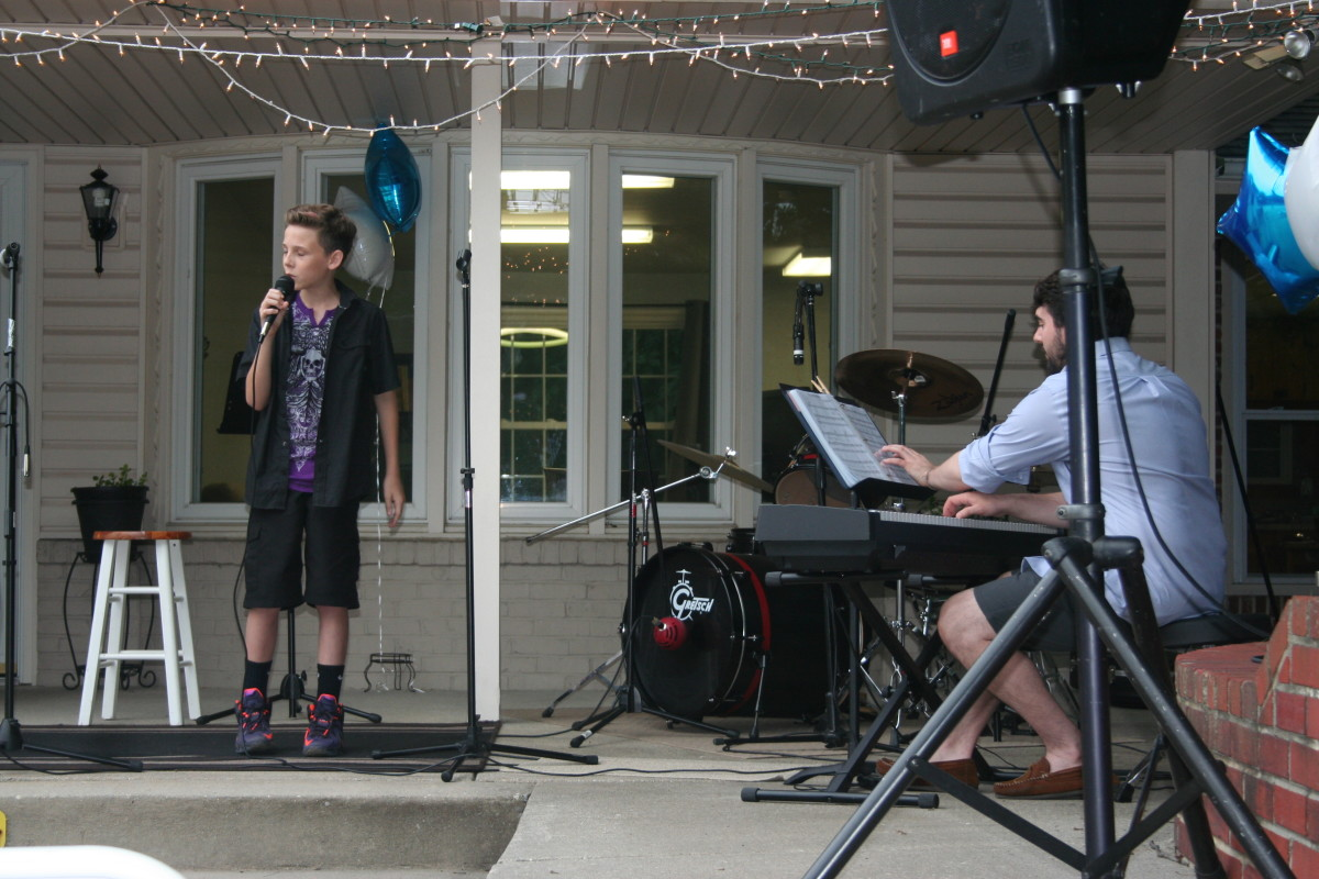 Resonance Student Colin S. performing with vocal teacher Christopher F.