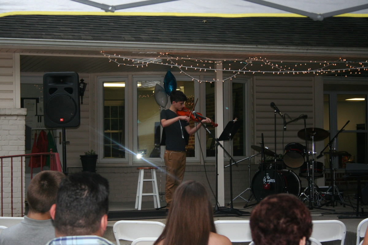 Resonance Student Ricky S. performing at the Resonance BBQ